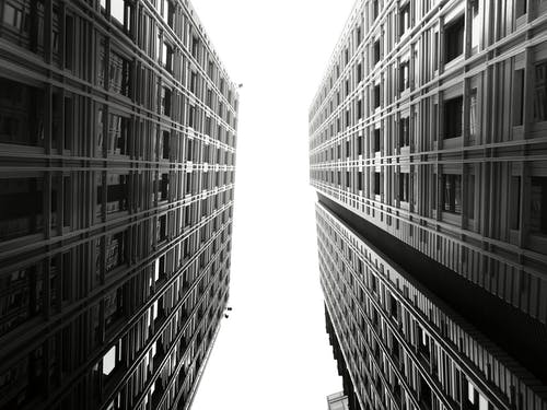 Grayscale Photography of Two Hi-rise Buildings