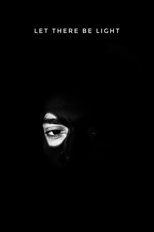 Ethnic man with dark eyes standing in dark room