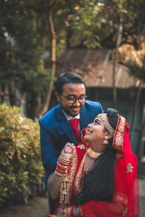 Happy Indian newlywed couple in traditional clothes