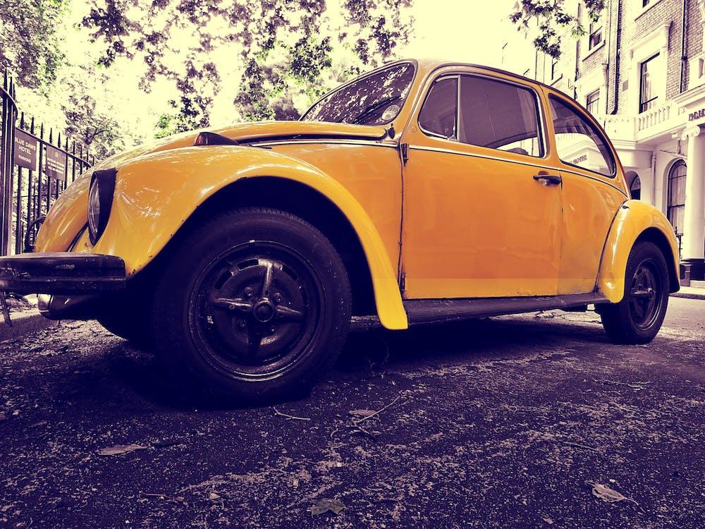 Closeup Photo of Yellow Volkswagen Beetle Coupe