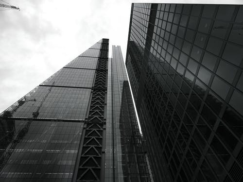 Glass Building Under Gray Sky
