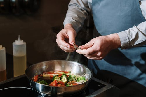 Person Holding Stainless Steel Bowl With Vegetable Salad