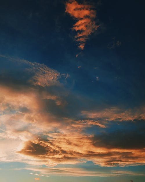 Picturesque cloudy sky during bright sundown