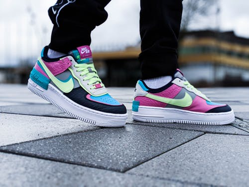 Person Wearing Nike Sneakers