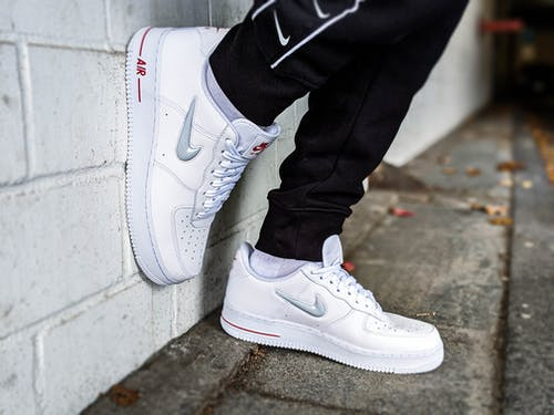 Close-Up Photo of a Person Wearing a Stylish Nike Air Force 1