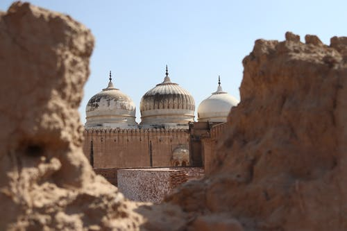 Domes of ancient Abbasi Mosque located in arid desert on territory of Derawar Fort in Pakistan
