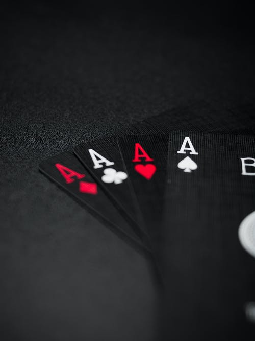 Black Playing Cards on Black Background