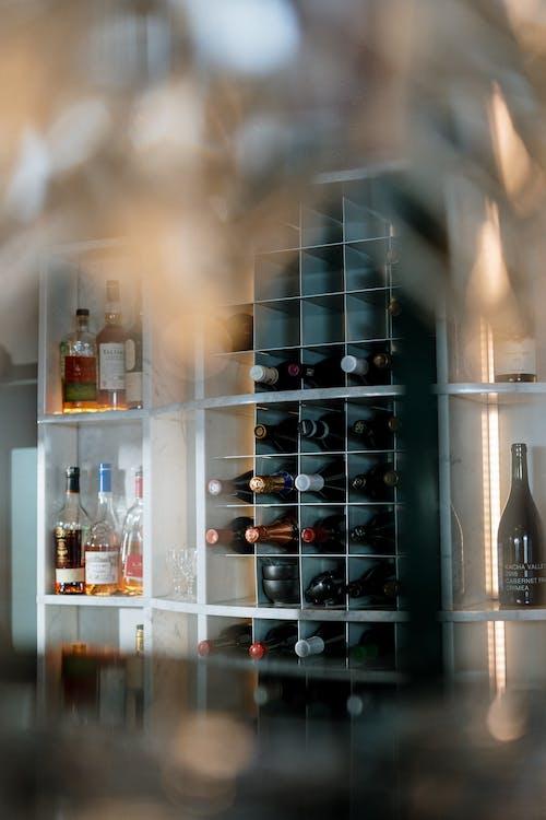 Wine Bottles on Shelf With Lights