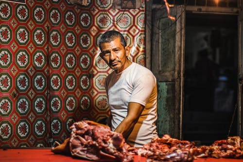 Free stock photo of meat shop, night photography, portrait, seller