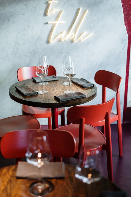 Brown Wooden Table With Red Chairs