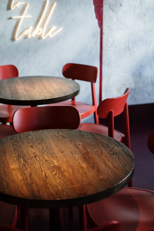 Brown Wooden Round Table and Red Chairs