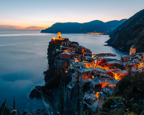 Houses on Cliff Near Body of Water