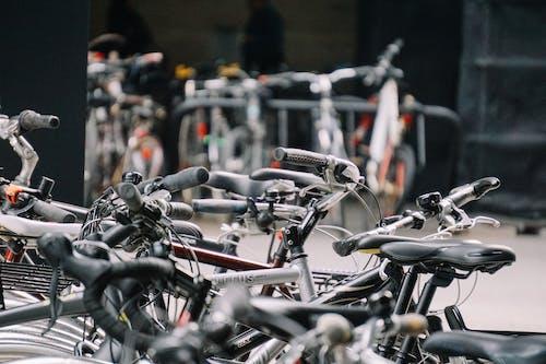 Bikes in parking space on street