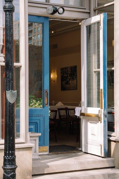 Opened blue doorway of city cafe