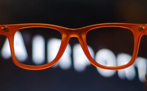 Kostenloses Stock Foto zu flughafen, opium, orange brille