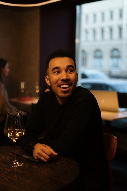Man in Black Long Sleeve Shirt Smiling