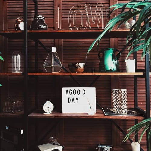 Shelves with decor and good day wish board