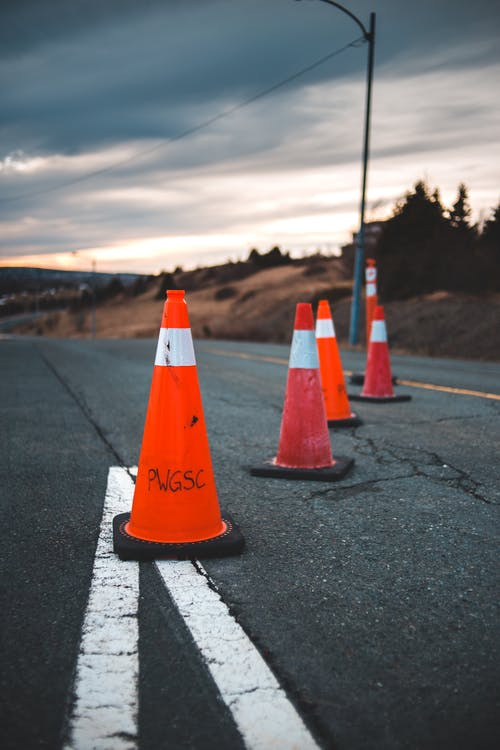 Safety cones placed on asphalt road