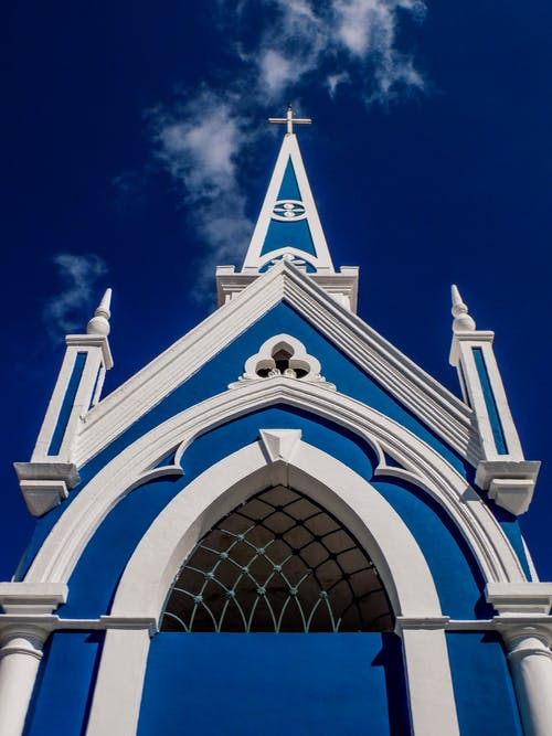 Low-Angle Shot of a Blue and White Church