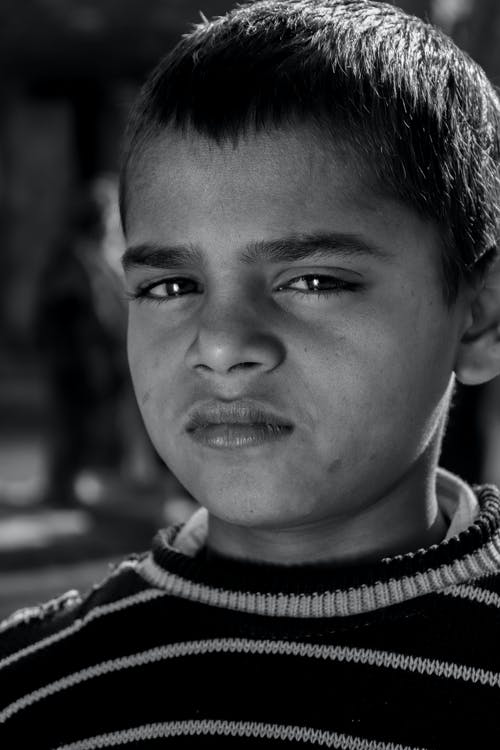 Grayscale Photo of Boy in Black and White Striped Crew Neck Shirt
