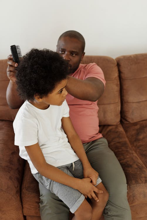 Father Brushing his Son's Hair