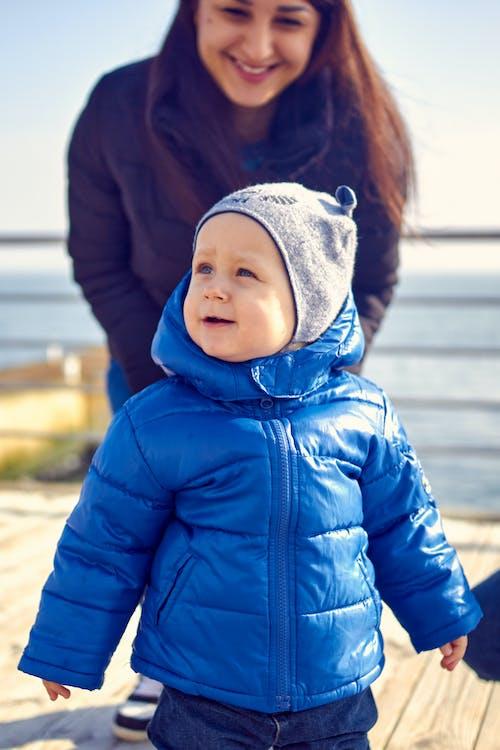 Photo of a Cute Kid Wearing a Blue Jacket