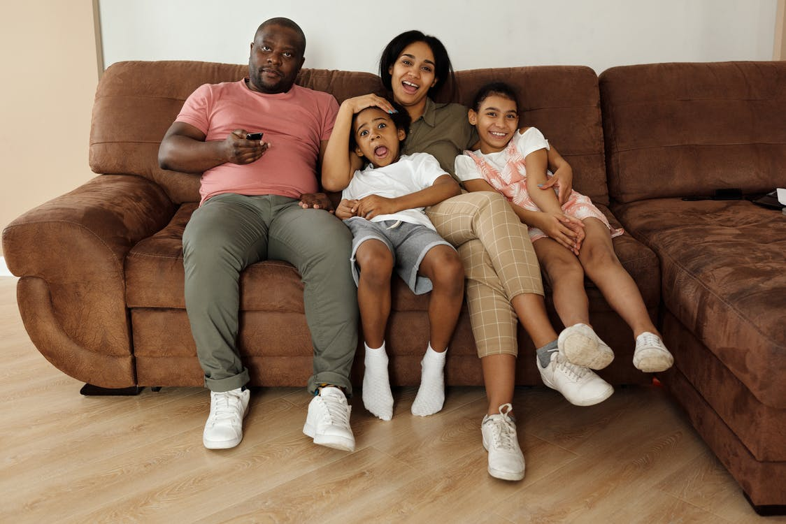 Family Sitting on a Brown Couch