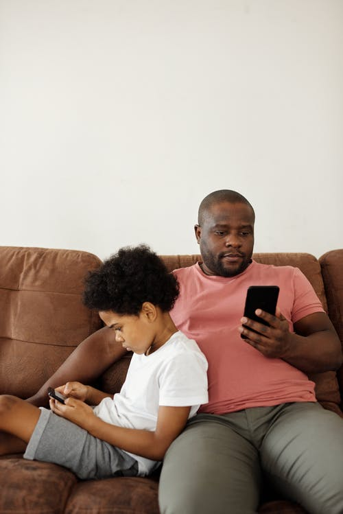 Father and Son using Smartphones