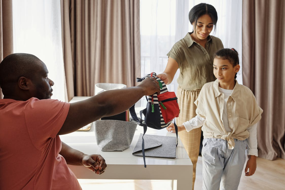 Parents Helping their Daughter to get Ready for School