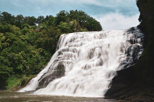 Waterfalls Near Green Trees Under Blue Sky
