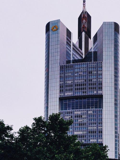 Modern glass skyscraper on gloomy day