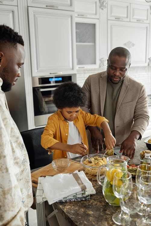 Father and Son Preparing Food at a Kitchen