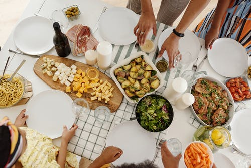 People around a Table With Food