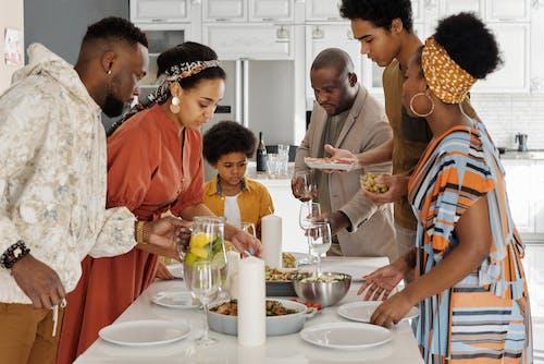Family Setting the Table for Dinner