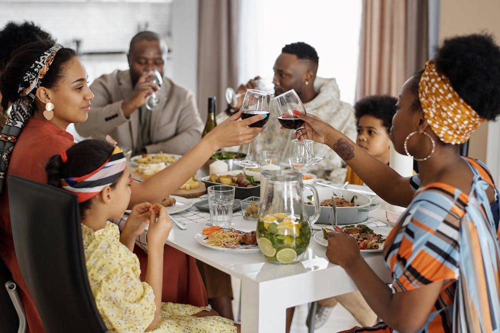 Family having dinner and celebrating. | Photo: Pexels