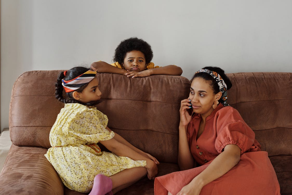 Mother and Children on a Sofa