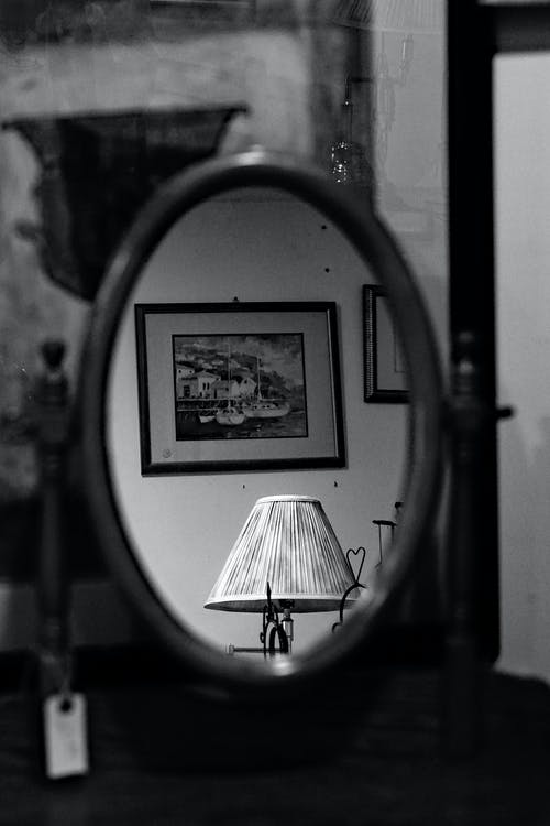 Shabby interior lamp and photo on wall