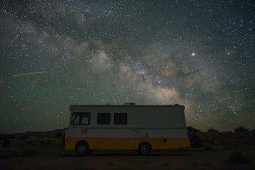 White and Yellow Van Under Starry Night