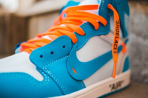 Colorful sneaker with bright laces on step