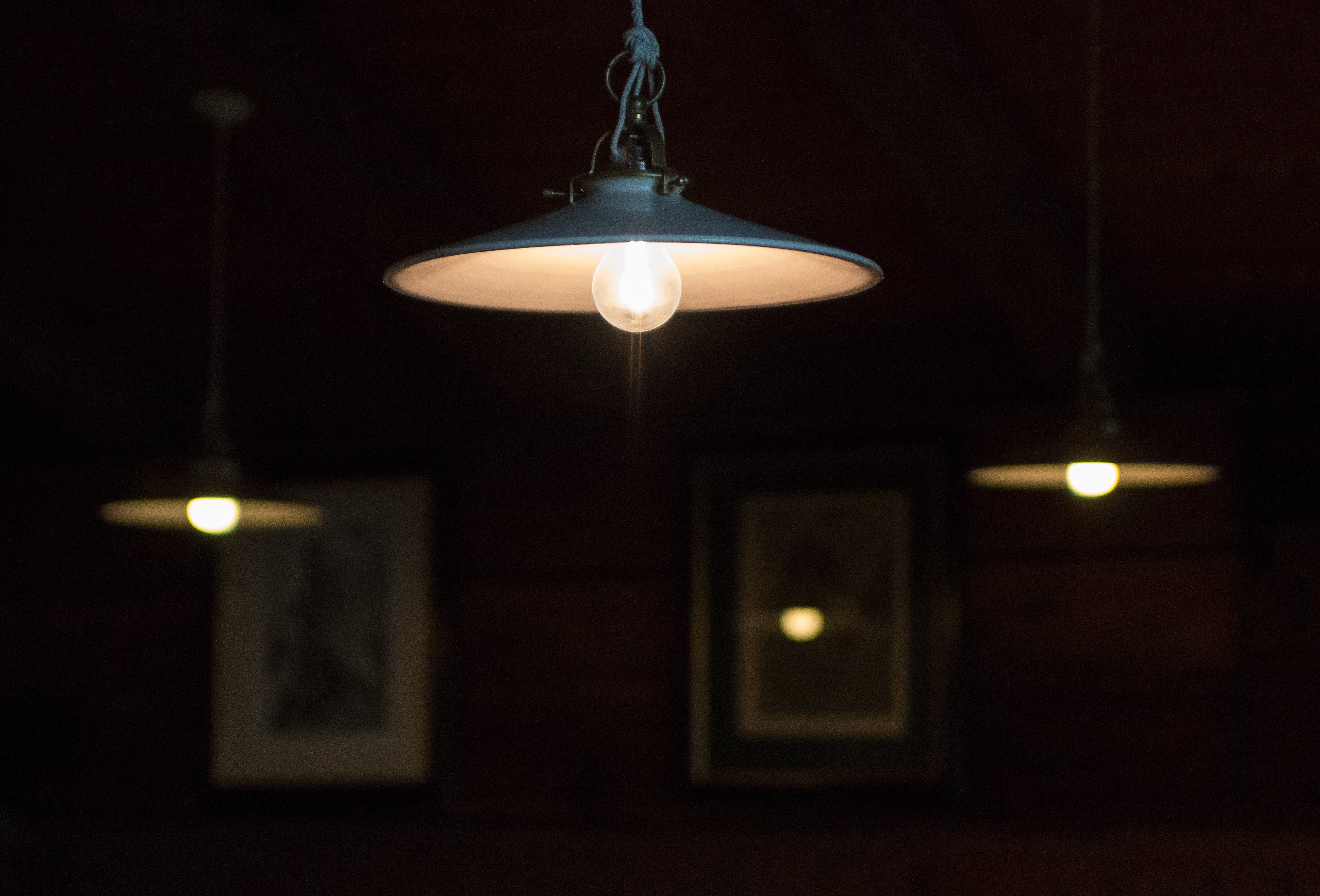 Three Turned-on Pendant Lamps in Room