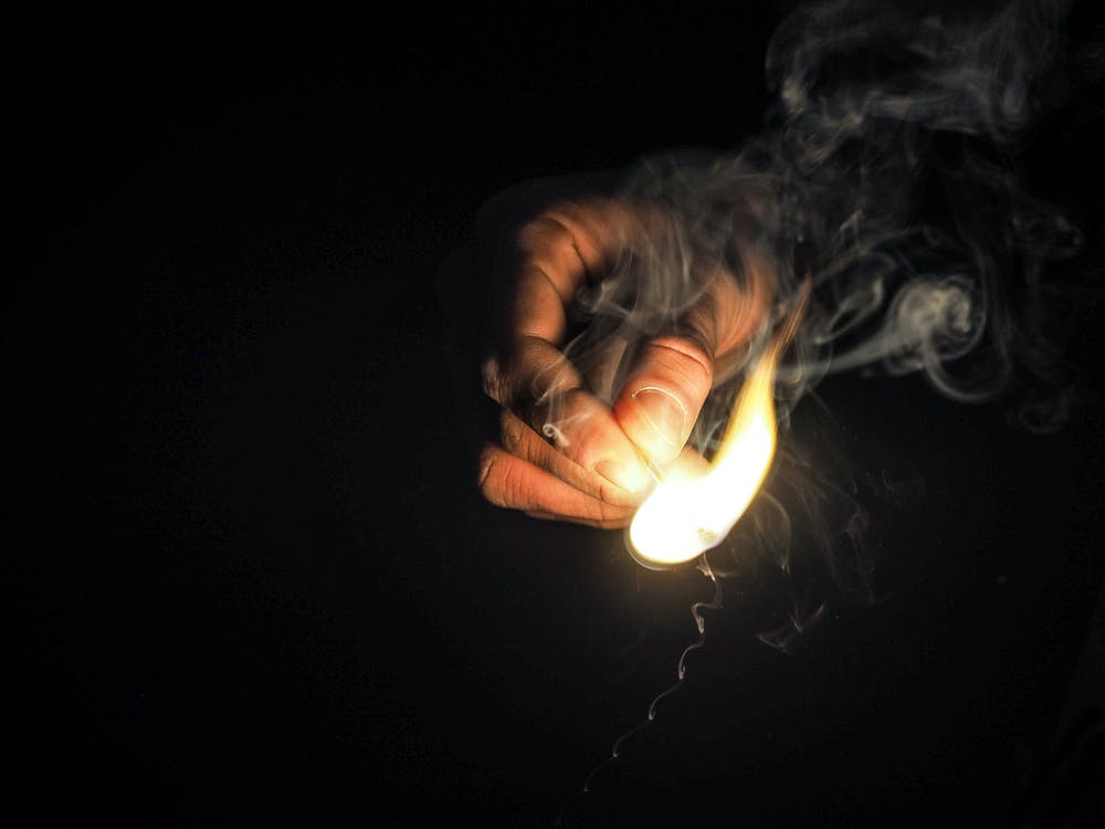 Person Holding Matchstick