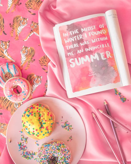 Magazine and Donuts on Pink Background