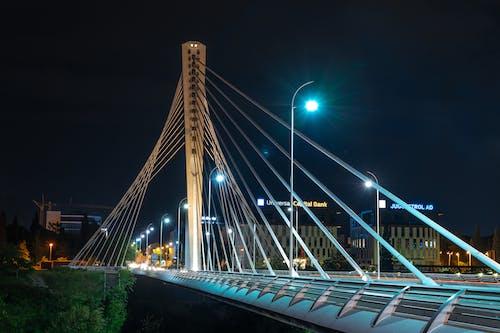 Illuminated contemporary bridge at night city