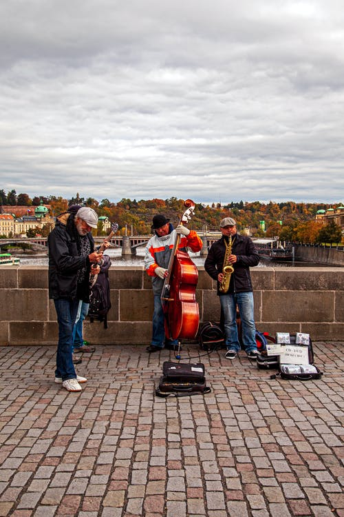 Street Performers Playing Music on a Bridge