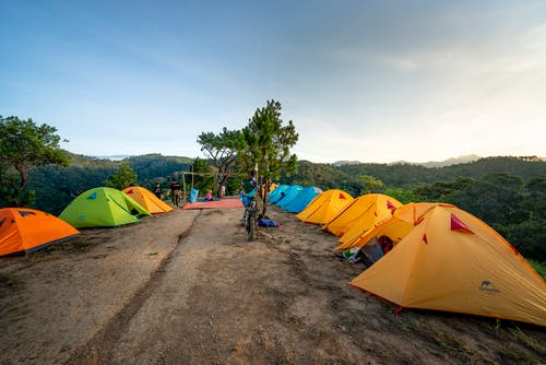 Campsite with colorful tents in mountainous countryside