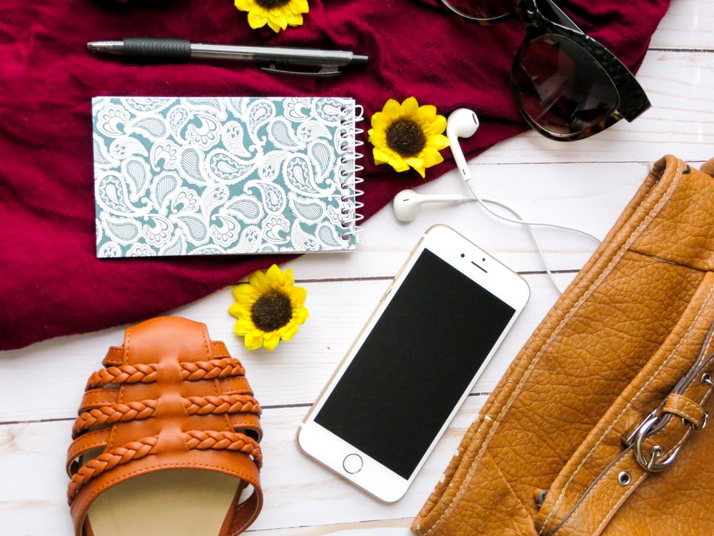 Flat Lay Photography of Iphone, Notebook, and Retractable Pen
