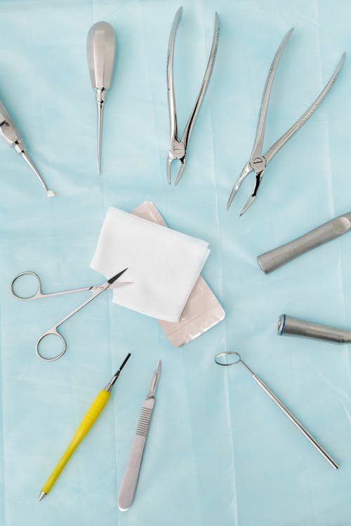Set of dental tools on blue surface