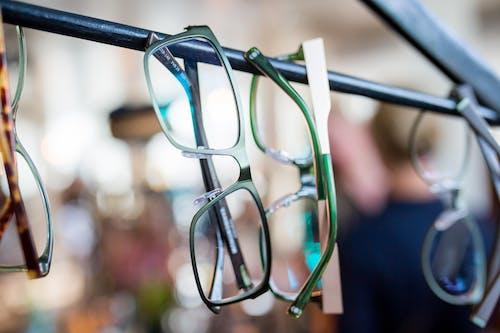 Black Framed Eyeglasses on Black Metal Bar