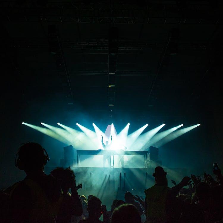 People Inside Dark Room With Spotlights