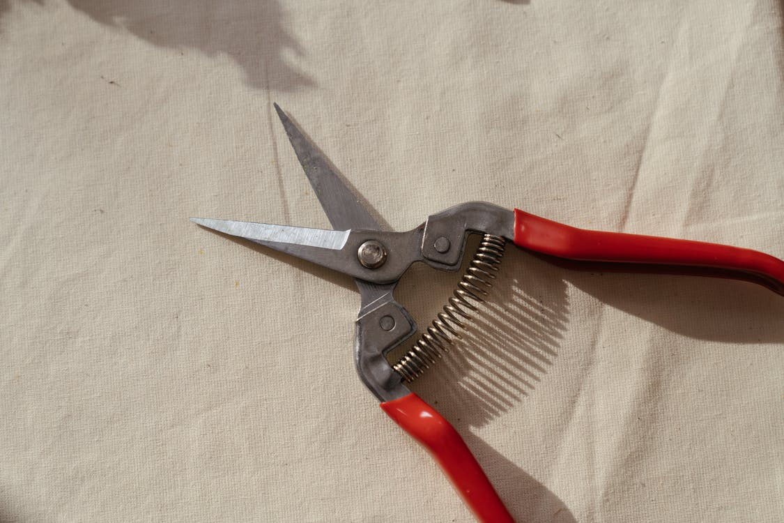 Red and Silver Hand Tool